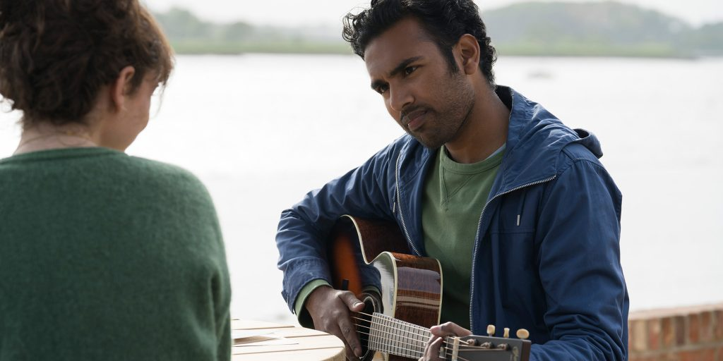 """(from left) Ellie (Lily James, back to camera) and Jack Malik (Himesh Patel) in """"Yesterday,"""" directed by Danny Boyle."""