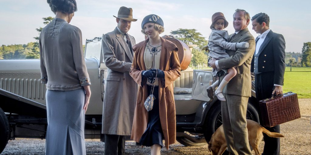 "This image released by Focus features shows Elizabeth McGovern, from left, Harry Hadden-Paton, Laura Carmichael, Hugh Bonneville and Michael Fox, right, in a scene from ""Downton Abbey."" The highly-anticipated film continuation of the ""Masterpiece"" series that wowed audiences for six seasons, will be released Sept. 13, 2019, in the United Kingdom and on Sept. 20 in the United States. (Jaap Buitendijk/Focus Features via AP)"